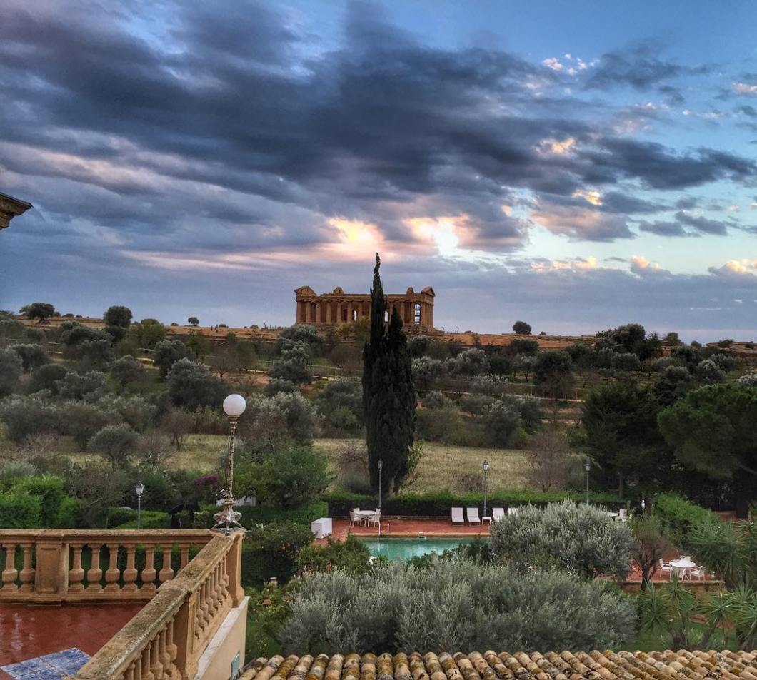 Back_in__Sicily_revisiting_a_few_of_our_favorite_places__like__Agrigento_and_the_Valley_of_Temples_-_the_sunrises___sunsets_are_epic_with_the_view_from_our_hotel_room_at__hotelvillaathena__Heading_to_Palermo_next__can_t_wait_for_the_markets_